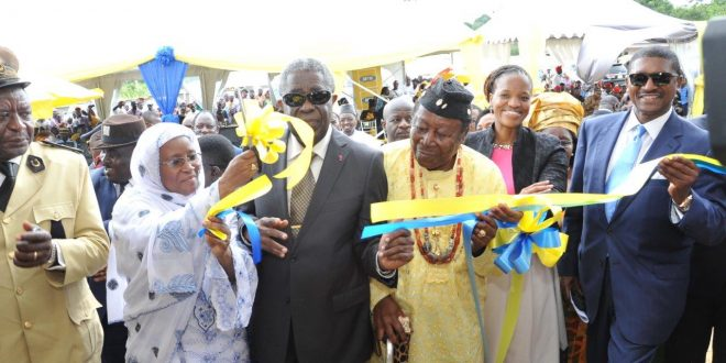 Cutting of symbolic ribbon in presence of His Royal Highness Victor E Mukete Paramount Chief of Bafaws Kumba (middle)