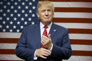Donald Trump speaks to supporters as he takes the stage for a campaign event in Dallas, Monday, Sept. 14, 2015. (AP Photo/LM Otero)
